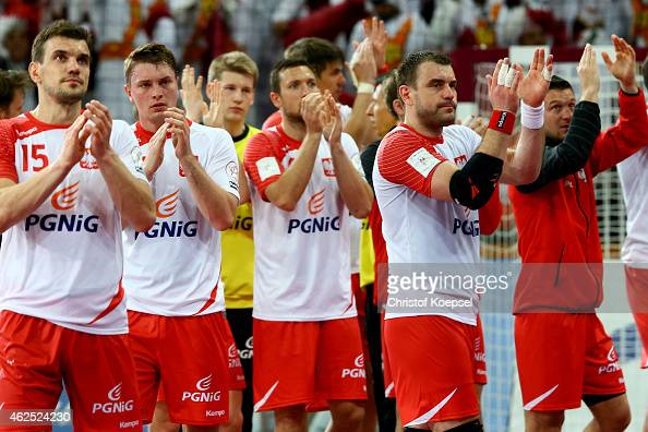 The team of Poland look dejected after the semi final match between Poland v Qatar during the Men's Handball World Championship at Lusail...