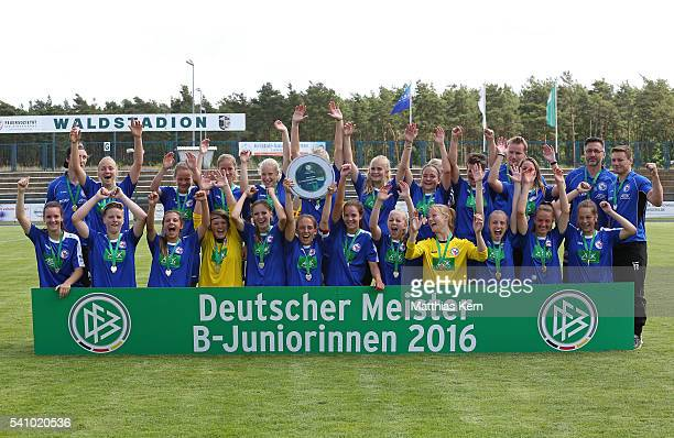 The team of Potsdam pose with the trophy after winning the U17 Girl's German Championship final match between 1FFC Turbine Potsdam and FSV Guetersloh...