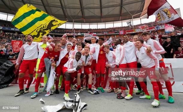 The team of RB Leipzig celebrate the participation of the UEFA Champions League in the next season after winning the Bundesliga match between Hertha...