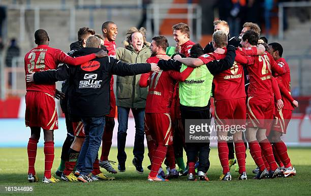 The team of Regensburg celebrates after winning the Second Bundesliga match between VfL Bochum and SSV Jahn Regensburg at Rewirpower Stadium on...