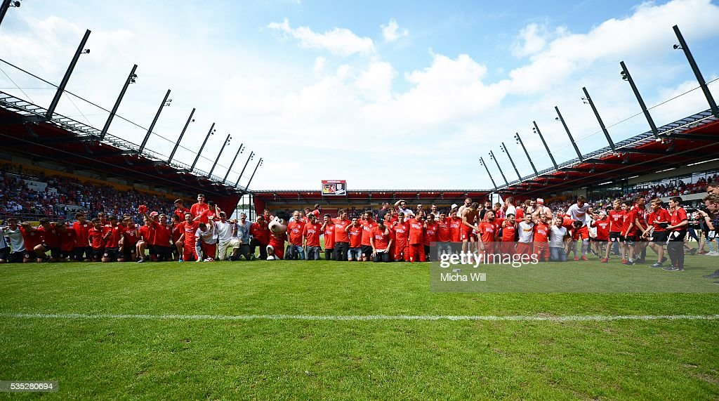 The team of Regensburg celebrates after winning the Third League play off second leg match between Jahn Regensburg and VfL Wolfsburg II at Continental Arena on May 29, 2016 in Regensburg, Germany.