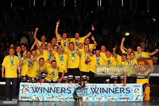 The team of RheinNeckar Loewen presents the winning trophy after winning the EHF Cup Final match between HBC Nantes and and RheinNeckar Loewen at...