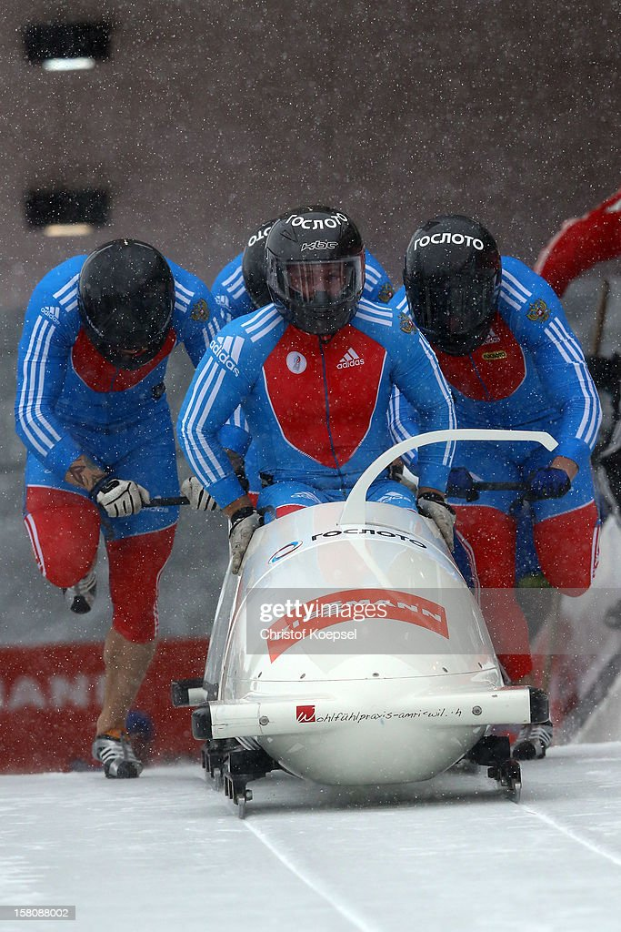 The team of Russia 3 with Alexey Stulnev, Denis Moiseychenkov, Aleksey Kireev and Yury Selihkov sprint during the four men's bob competition during the FIBT Bob & Skeleton World Cup at Bobbahn Winterberg on December 9, 2012 in Winterberg, Germany.