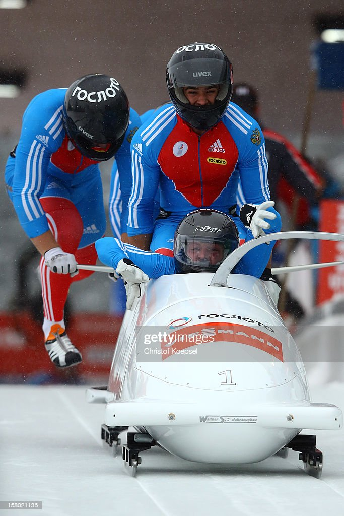The team of Russia with Alexander Zubkov, Alexey Negodaylo, Dmitry Trunenkov and Maxim Mokrousov sprints during the four men's bob competition during the FIBT Bob & Skeleton World Cup at Bobbahn Winterberg on December 9, 2012 in Winterberg, Germany.