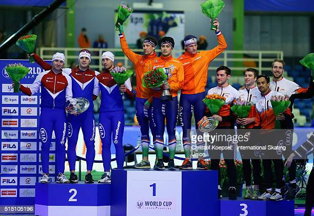 The team of Russia with Rusland Murashov Kirill Golubev and Aleksey Yesin poses during the medal ceremony after winning the 2nd place the team of the...
