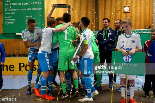 The team of Schalke celebrates with the winning trophy on the podium of the B and Juniors German Indoor Football Championship at Sporthalle West on...