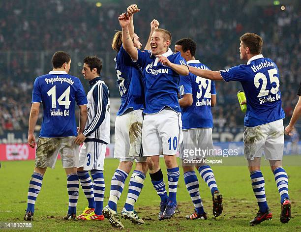 The team of Schalke with Kyriakos Papadopoulos Christian Fuchs Lewis Holtby and KlaasJan Huntelaar of Schalke celebrates the 20 v ictory after the...