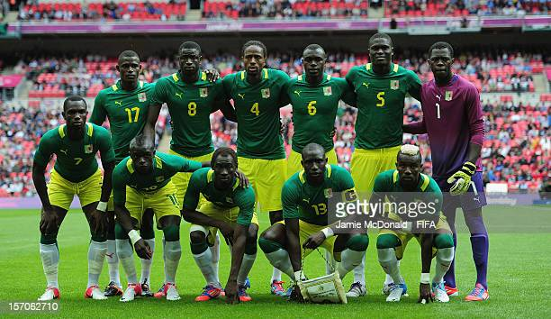 The team of Senegal line up during the Men's Football first round Group A Match between Senegal and Uruguay on Day 2 of the London 2012 Olympic Games...