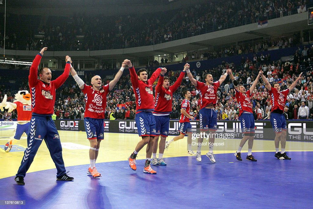 The team of Serbia celebrates the 24-21 victory after the Men's European Handball Championship second round group one match between Serbia and Sweden at Beogradska Arena on January 23, 2012 in Belgrade, Serbia.