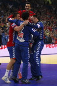 The team of Serbia celebrates the 2622 victory after the Men's European Handball Championship second semi final match between Serbia and Croatia at...