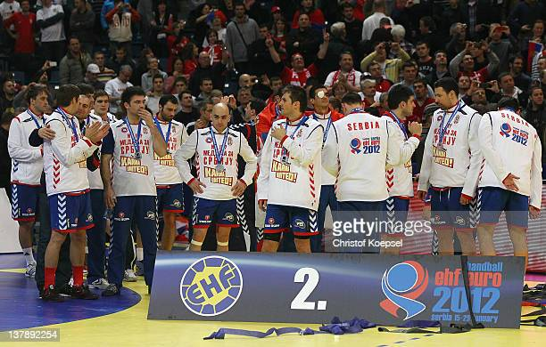 The team of serbia looks dejected on thze podium after losing 1921 the Men's European Handball Championship final match between Serbia and Denmark at...