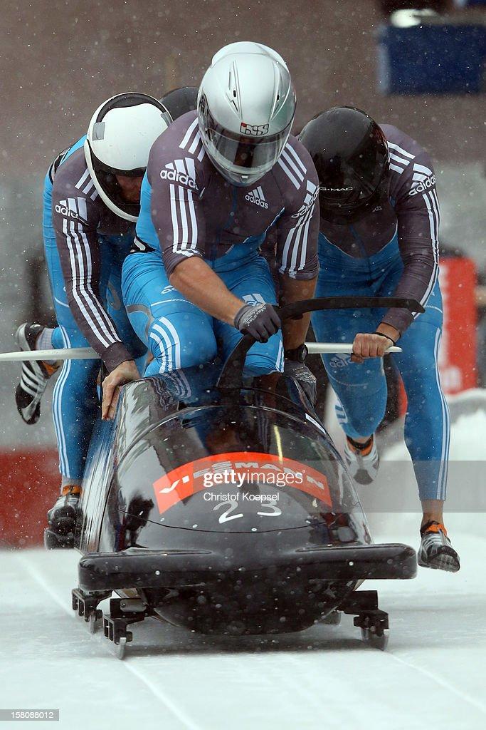 The team of Serbia with Vuk Radjenovic, Uros Stegel, Nikola Milinkovic and Damjan Zlatnar sprint during the four men's bob competition during the FIBT Bob & Skeleton World Cup at Bobbahn Winterberg on December 9, 2012 in Winterberg, Germany.