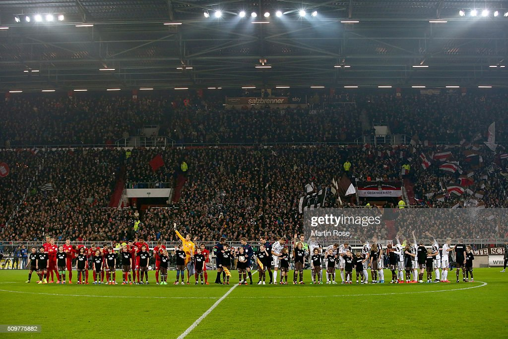 The team of St. Pauli and of Leipzig line up before the second Bundesliga match between FC St. Pauli and RB Leipzig at Millerntor Stadium on February 12, 2016 in Hamburg, Germany.