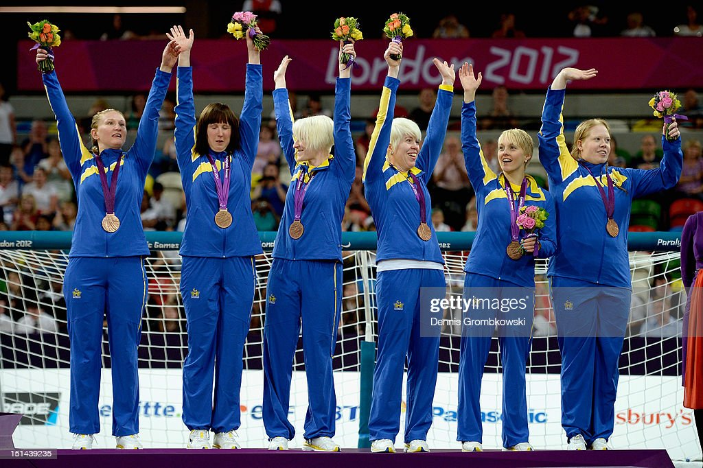 The team of Sweden poses on the podium after winning the bronze in the Women's Team Goalball competition on day 9 of the London 2012 Paralympic Games at The Copper Box on September 7, 2012 in London, England.