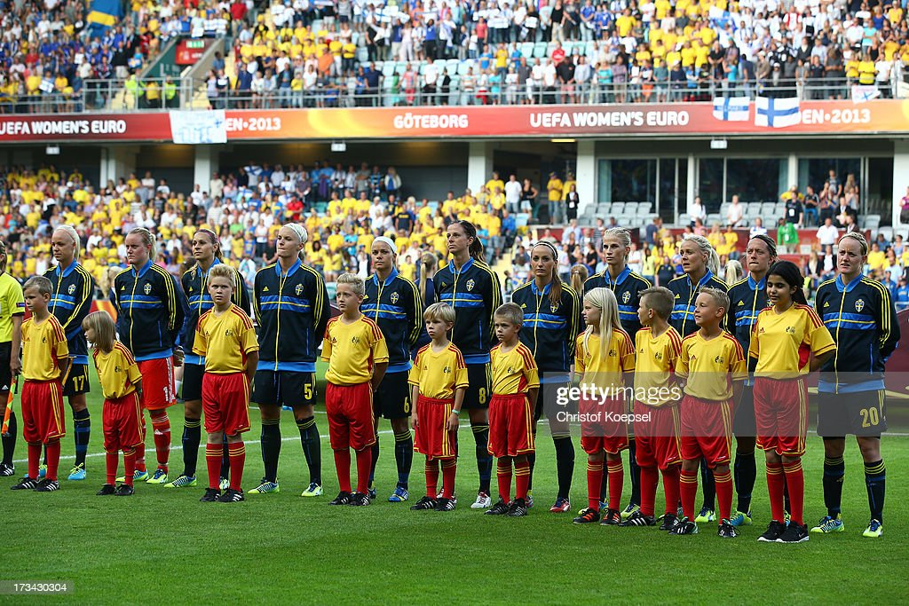 The team of Sweden stands for the national anthem during the UEFA Women's EURO 2013 Group A match between Finland and Sweden at Gamla Ullevi Stadium on July 13, 2013 in Gothenburg, Sweden.