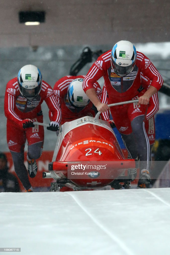 The team of Switzerland 1 with Rico Peter, Thomas Ruf, Michael Keel and Simon Friedl sprints during the four men's bob competition during the FIBT Bob & Skeleton World Cup at Bobbahn Winterberg on December 9, 2012 in Winterberg, Germany.
