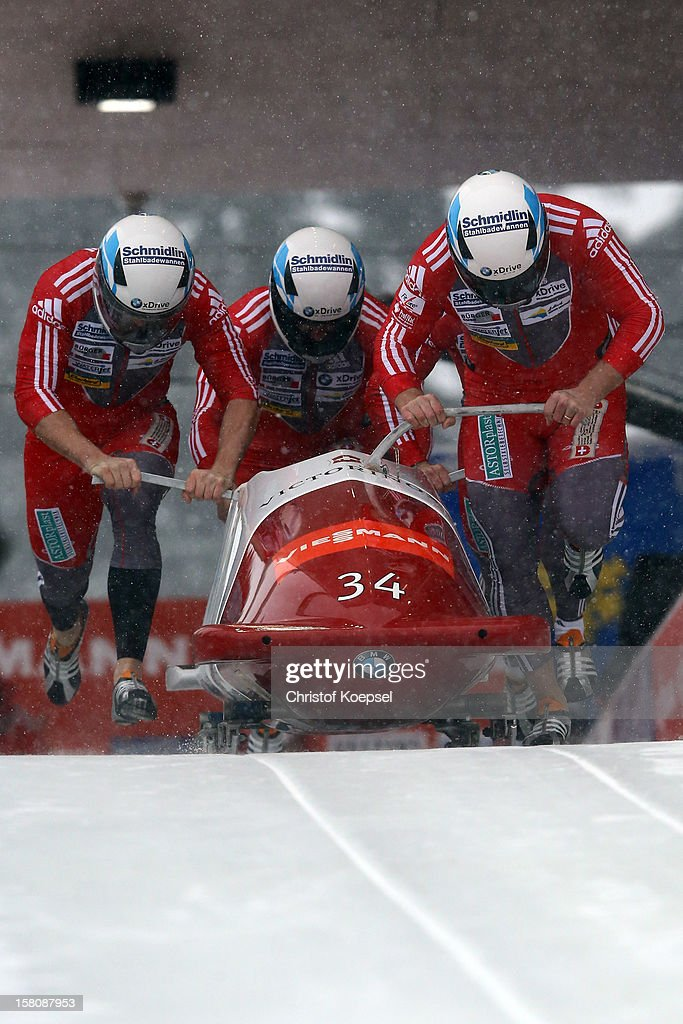 The team of Switzerland 2 with Beat Hefti, Alex Baumann, Thomas Lamparter and Juerg Egger during the four men's bob competition during the FIBT Bob & Skeleton World Cup at Bobbahn Winterberg on December 9, 2012 in Winterberg, Germany.