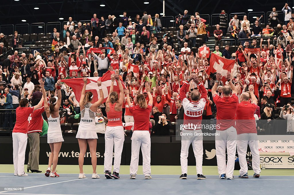 The team of Switzerland celebrates on Day 2 of the 2016 FedCup World Group Round 1 match between Germany and Switzerland at Messe Leipzig on February 7, 2016 in Leipzig, Germany.
