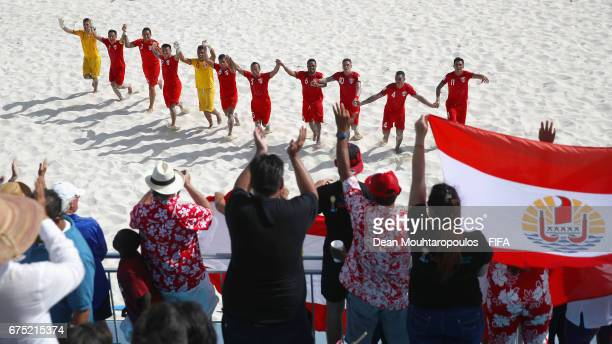 The team of Tahati celebrate victory after he FIFA Beach Soccer World Cup Bahamas 2017 group D match between Tahiti and Japan at National Beach...