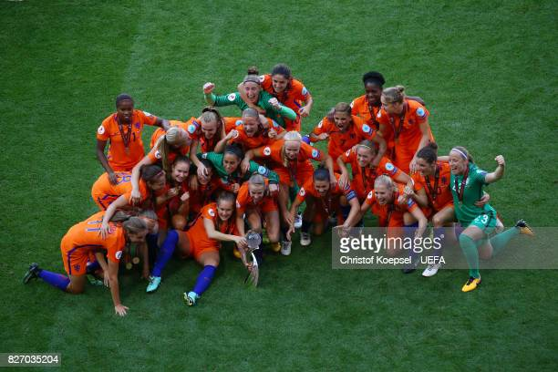 The team of the Netherlands celebrates with the winning lifts the trophy on the podium after winning after the Netherlands v Denmark UEFA Women's...