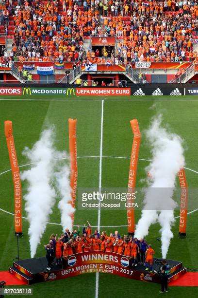 The team of the Netherlands celebrates with the winning trophy on the podium after the Netherlands v Denmark UEFA Women's Euro 2017 Final at De...