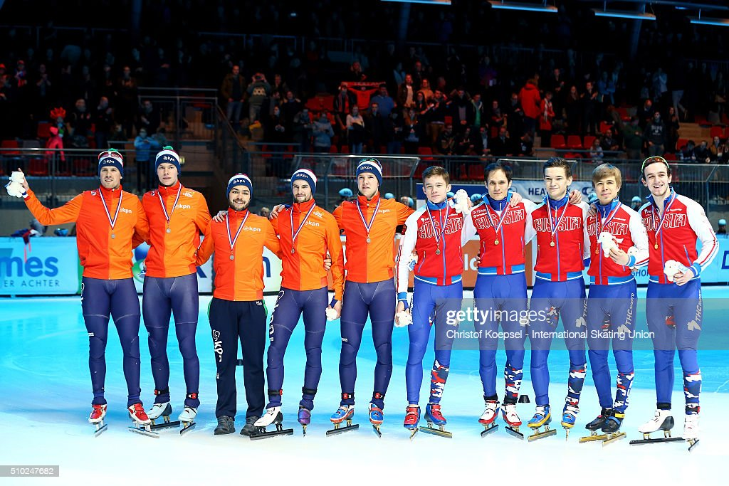 The team of the Netherlands poses during the medal ceremony after winning the 2nd place and the team of Russia poses during the medal ceremony after winning the 1st place of the men 5000m relay final A during Day 3 of ISU Short Track World Cup at Sportboulevard on February 14, 2016 in Dordrecht, Netherlands.