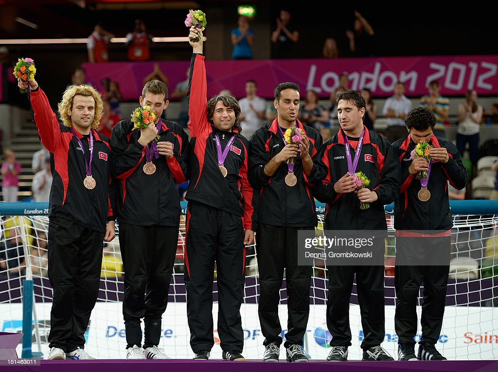 The team of Turkey celebrates after winning the bronze in the Men's Team Goalball competition on day 9 of the London 2012 Paralympic Games at The Copper Box on September 7, 2012 in London, England.