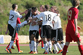 The team of U17 Germany celebrates a goal during the international friendly match between U17 Portugal and U17 Germany at the Bela Vista stadium on...