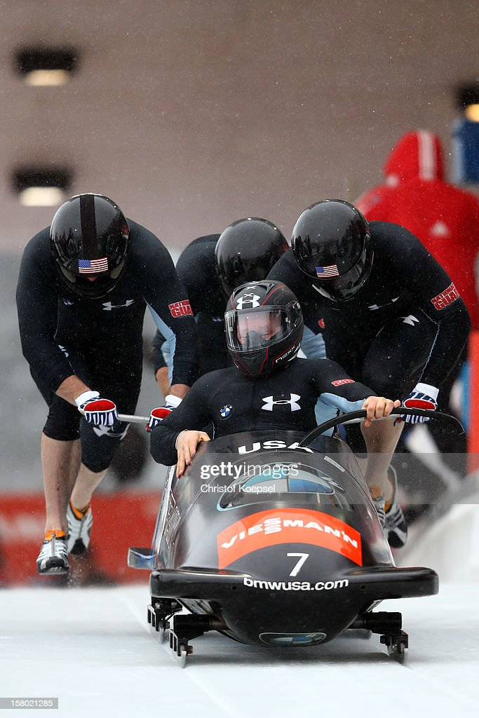 The team of United States 1 with Steven Holcomb, Justin Olsen, Steven Langton and Curtis Tomasevicz sprint during the four men's bob competition during the FIBT Bob & Skeleton World Cup at Bobbahn Winterberg on December 9, 2012 in Winterberg, Germany.