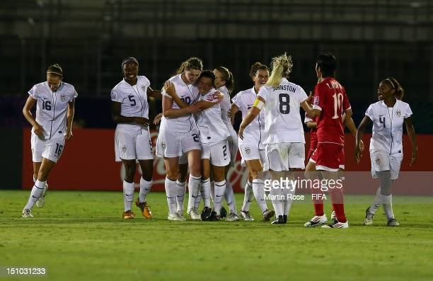 The team of USA celebrate their opening goal during the FIFA U20 Women's World Cup Japan 2012 Quarter Final match between Korea DPR and USA at Komaba...