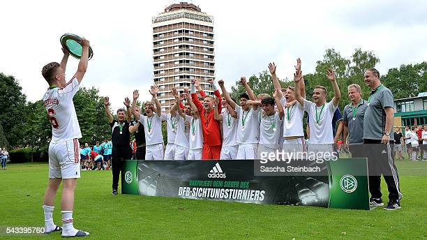 The team of Westfalen celebrates with the trophy after winning the U15 selection tournament at Sport School Wedau on June 28 2016 in Duisburg Germany