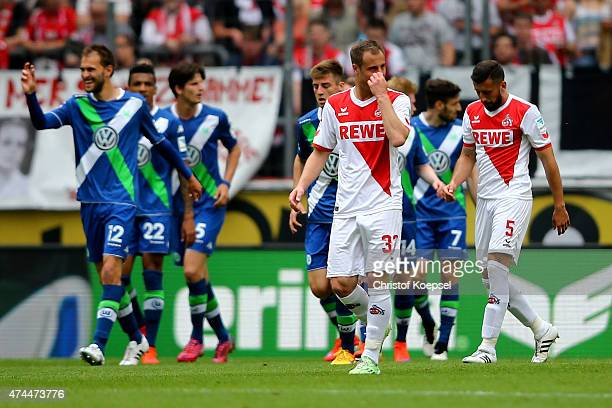 The team of Wolfsburg celebrates the second goal and Matthias Lehmann and Dominik Maroh of Koeln look dejected during the Bundesliga match between 1...