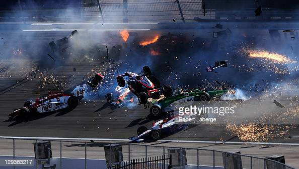 The Team Penske Dallara Honda of Will Power of Australia flies in the air during a 15 car pileup during the Las Vegas Indy 300 part of the IZOD...