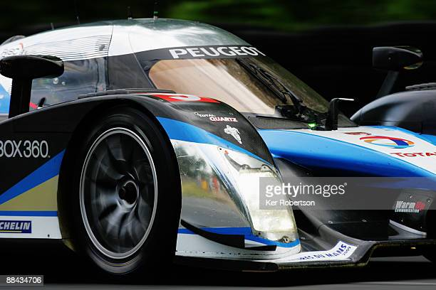 The Team Peugeot Total 908 HDi FAP of Alex Wurz of Austria David Brabham of Australia and Marc Gene of Spain drives during qualifying for the 77th...