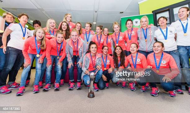 The team poses during the Germany U20 Women's Welcome Home Reception As World Champions at Frankfurt International Airport on August 26 2014 in...