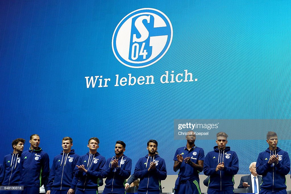 The team Schalke enters the stage during the FC Schalke 04 general assembly at Veltins Arena on June 26, 2016 in Gelsenkirchen, Germany.