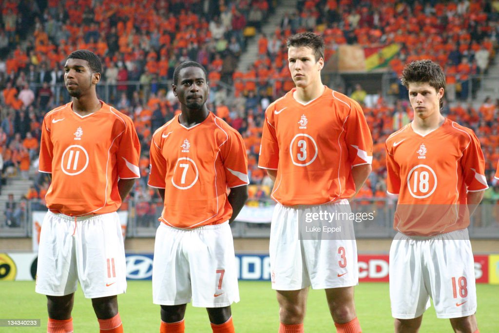The team stand while the Dutch national anthem is played at the Parkstad Limburg Stadium in Kerkrade, Netherlands. From left to right: <a gi-track='captionPersonalityLinkClicked' href=/galleries/search?phrase=Ryan+Babel&family=editorial&specificpeople=543539 ng-click='$event.stopPropagation()'>Ryan Babel</a>, Quincy Owusu Abeyie, Ron Vlaar and Tim Vincken