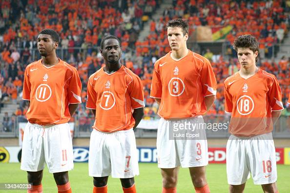 The team stand while the Dutch national anthem is played at the Parkstad Limburg Stadium in Kerkrade Netherlands From left to right Ryan Babel Quincy...