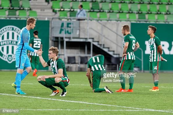 The teammates of Ferencvarosi TC after the lost penalty shootout from left to right Denes Dibusz Oliver Husing Stanislav Sestak Gergo Lovrencsics...