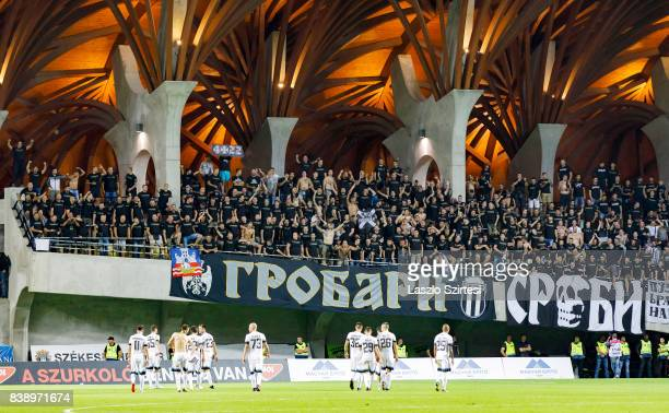 The teammates of FK Partizan give thanks to the ultras after the UEFA Europa League Playoffs 2nd Leg match between Videoton FC and FK Partizan at...