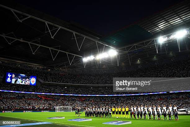 The teams and officials line up prior to the UEFA Champions League match between Tottenham Hotspur FC and AS Monaco FC at Wembley Stadium on...