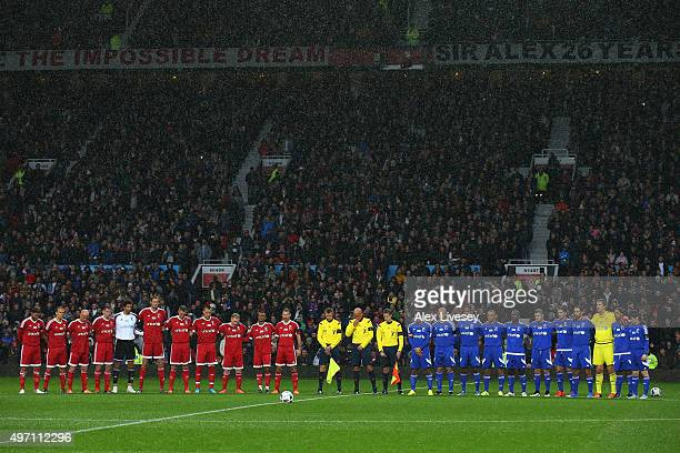 The teams and officials observe a silence in remembrance to the victims of the previous day's terror attacks in Paris prior to kickoff during the...