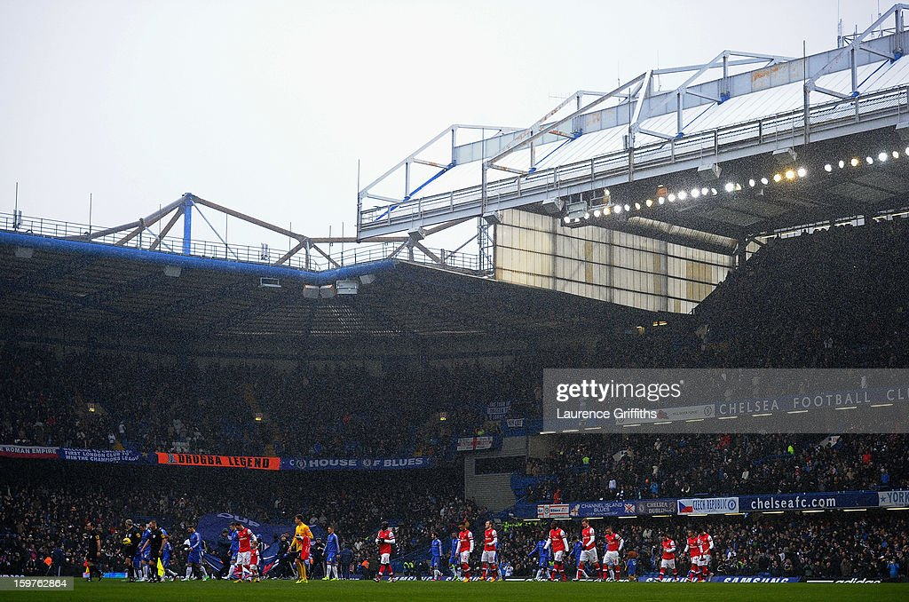 The teams and officials walk on to the pitch prior to the Barclays Premier League match between Chelsea and Arsenal at Stamford Bridge on January 20, 2013 in London, England.