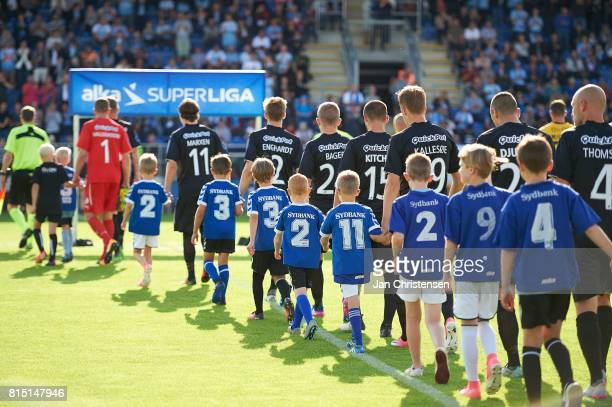 The teams and referees walk on to the pitch prior to the Danish Alka Superliga match between SonderjyskE and Randers FC at Sydbank Park on July 15...