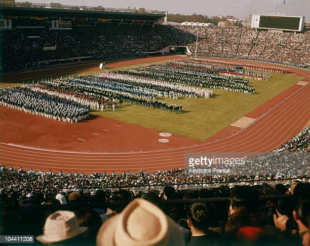 The teams are marching in the stadium during the Tokyo Olympic Games opening ceremony