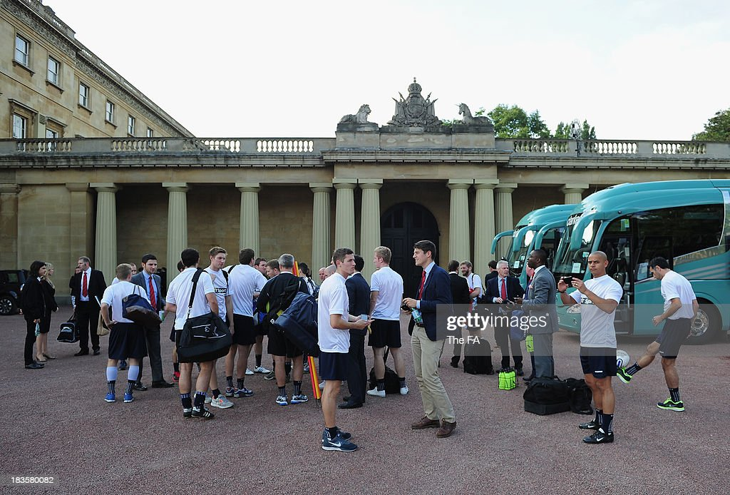 The teams arrive for the first ever football match at Buckingham Palace between Civil Service FC and Polytechnic FC as part of The FA's 150th anniversary and an awards ceremony celebrating football's grassroots heroes at Buckingham Palace on October 7, 2013 in London, England.
