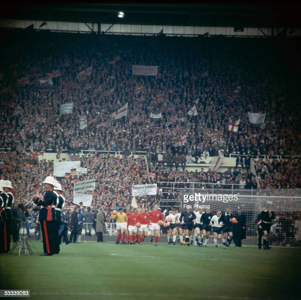 The teams arrive on the pitch at Wembley Stadium for the 1966 World Cup Final match between England and West Germany which England won 42 after extra...