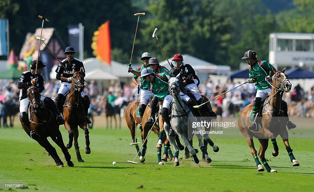 The teams compete during the The Veuve Clicquot Gold Cup for the British Open Polo Championship Final between Dubai and Zacara at Cowdray Park Polo Club on July 21, 2013 in Midhurst, England.