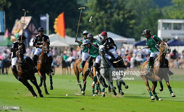 The teams compete during the The Veuve Clicquot Gold Cup for the British Open Polo Championship Final between Dubai and Zacara at Cowdray Park Polo...