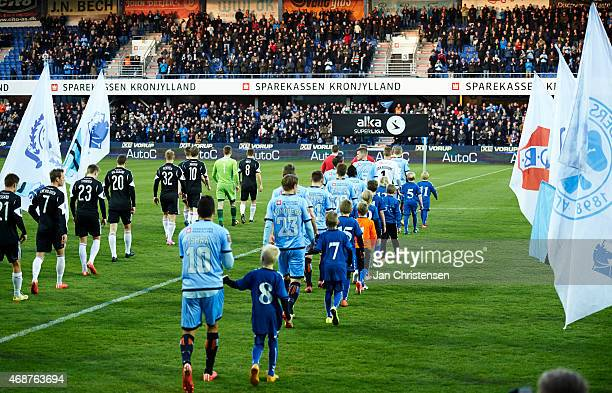 The teams during walk inn prior to the Danish Alka Superliga match between Randers FC and AaB Aalborg at AutoC Park Randers on April 06 2015 in...